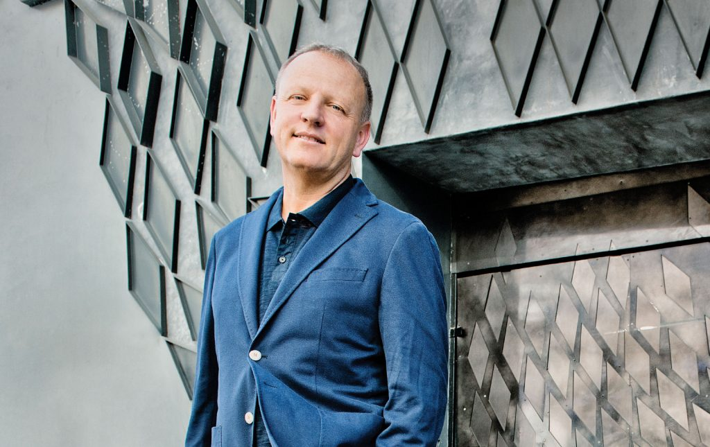 Canoo Co-Founder Stefan Krause has high ambitions to find a solution to reduce high-volume traffic while also making large cities cleaner and quieter. (Image © Canoo)