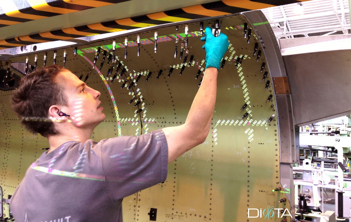 At Dassault Aviation, Diota's augmented reality (AR) system guides operators in a diverse and complex assembly task. Instructions displayed on the assembly include which operations to carry out, as well as tool diameters and machine types to use. (Image © Diota)