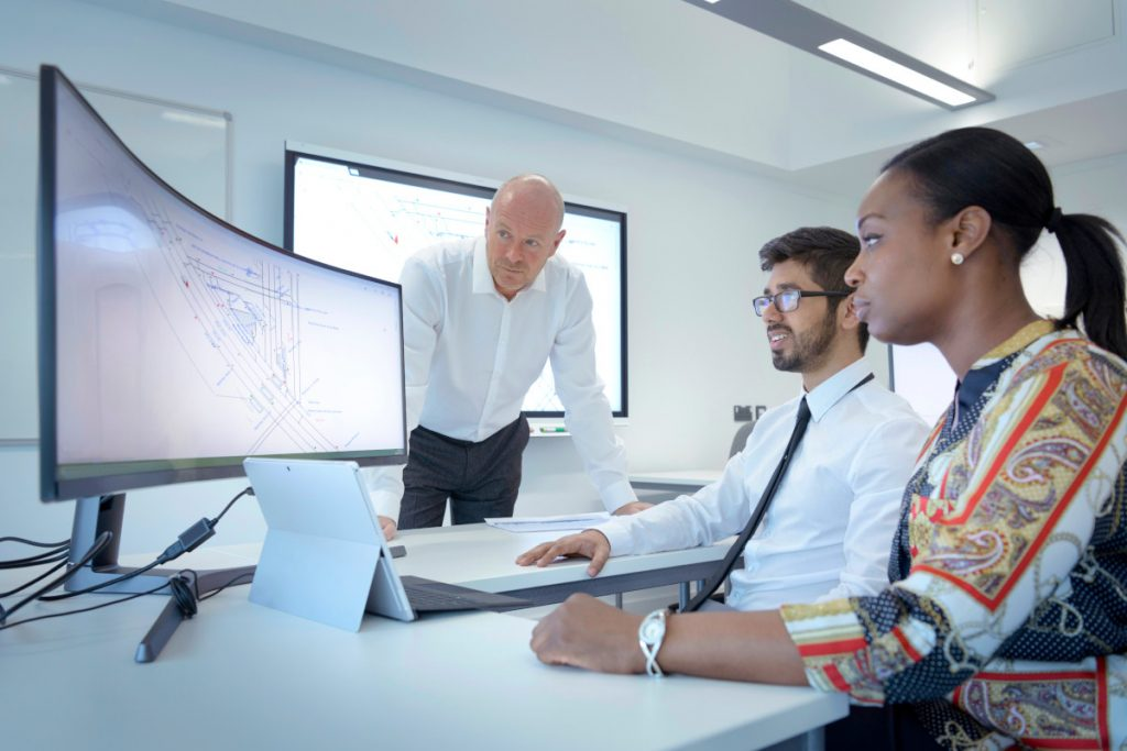 When teaching institutions partner with business leaders to develop courses and degree programs, students graduate with marketable knowledge and skills and companies can hire the talented workforce they need to thrive. (Image © Monty Rakusen / Getty Images)