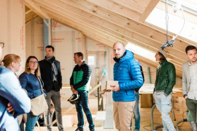 CEO François Cordier (right) conducts a tour of a home being built with Leko Labs' Design for Manufacturing and Assembly (DfMA) processes. Its online portal helps the company to scale quickly through instant online collaboration with international partners. (Image © Leko Labs / Picto Communications)