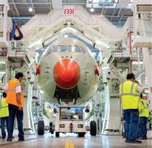 An Airbus A350 XWB moves down the assembly line. By switching from 2D drawings to enriched 3D models, Airbus reduced the time required to update an electrical harness installation by 50%. (Image © Airbus / P. Pigeyre)