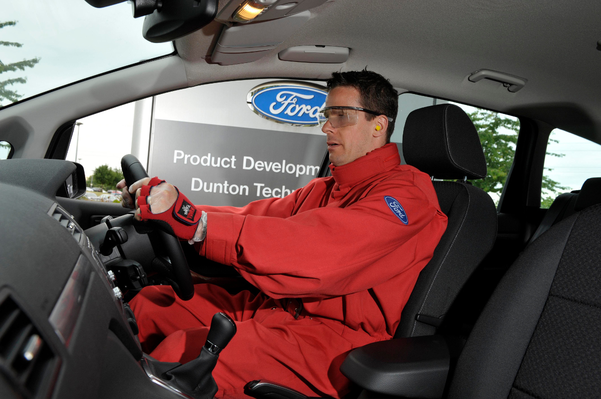 "Ford Motor Company, together with Nissan and MIT, developed an ""elder"" suit to simulate aging. When worn, a person feels they've aged 30+ years due to significantly reduced mobility and vision. The goal is to help automobile designers understand how elderly drivers move and see. (Image © Ford Motor Company)"