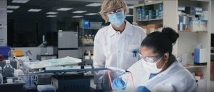 Sanofi scientists in Meriden, Connecticut, work on developing a potential vaccine for COVID-19, one of the many critical onsite activities supported by Sanofi's remote workforce during the pandemic. Sanofi executives point to the global pharmaceutical company's fast, smooth transition to a cloud-enabled, work-from-home model for 70% of its employees as one of the benefits of its digital transformation. (Image © Sanofi)
