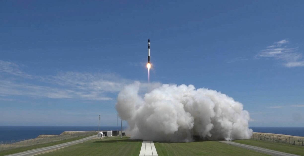 """New Zealand-based Rocket Lab focuses on launching satellites with just a 4-month wait, via its augmented Electron smallsat launch vehicle service. The company also manufactures satellites; its Photon can carry payloads as heavy as 375 pounds (170 kilograms). To deal with the challenge of """"space junk,"""" Rocket Lab also has demonstrated a """"drag sail"""" technology for moving out-of-service satellites into Earth's atmosphere, where friction incinerates them. (Image © Rocket Lab)"""