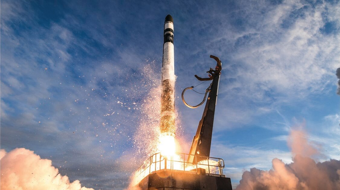 """The New Space model begins with launching payloads, like this liftoff of Rocket Lab's Electron rocket on a mission for NASA. """"No launch, no space,"""" said Phillip Ingle, a managing director in investment banking at Morgan Stanley. """"Companies are trying to continually lower launch costs until [rockets] can be thought of as another form of transportation – the bus that gets you there."""" Lower costs facilitate the New Space ecosystem's virtuous cycle: Launch companies depend on satellites to earn revenues, and satellite companies need launch companies to put their customers' payloads into orbit. (Image © Trevor Mahlmann)"""